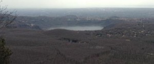 A view of lake Nemi and in the distance the Mediterranean sea.